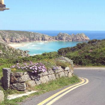 Coast road, Cornwall. Photo about cliffs, coast, summer, view, cornwall, waves, flowers, road, coun