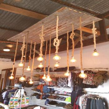 Corrugated metal chandelier w rope wrapped cords. Only at  RENO- We Make Things.
